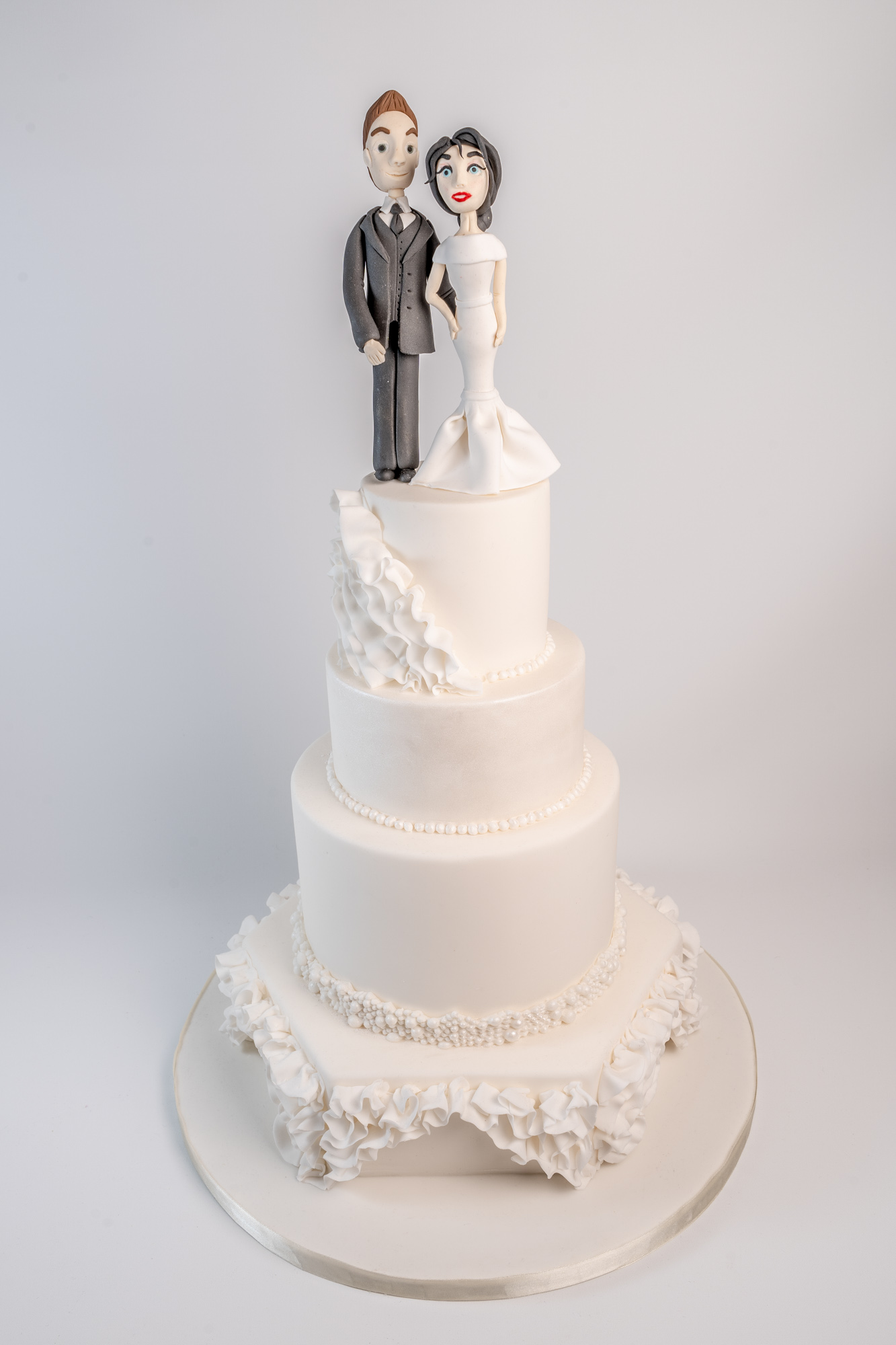 4 Tier pure white wedding cake