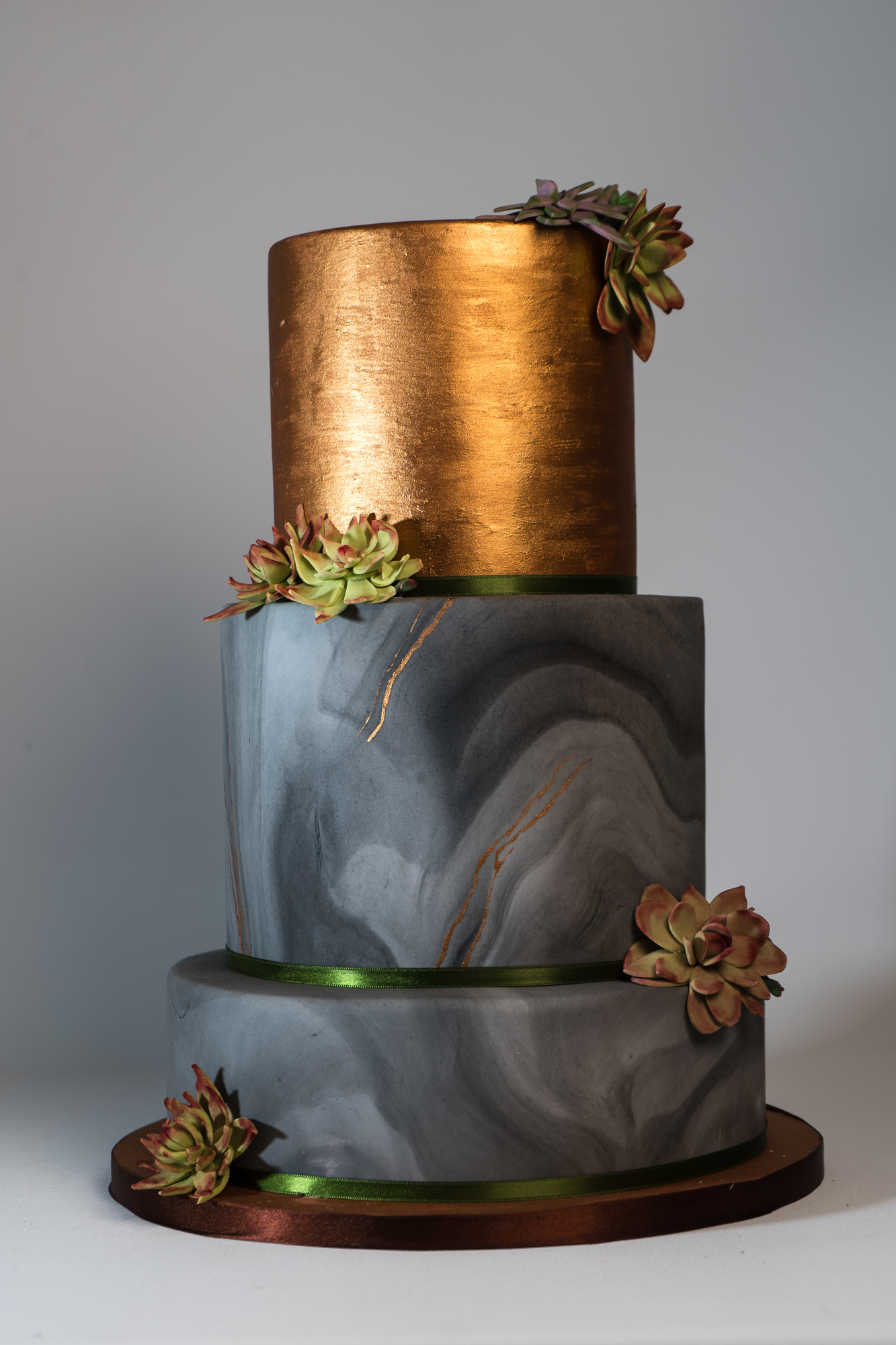 Abstract gold and marble wedding cake