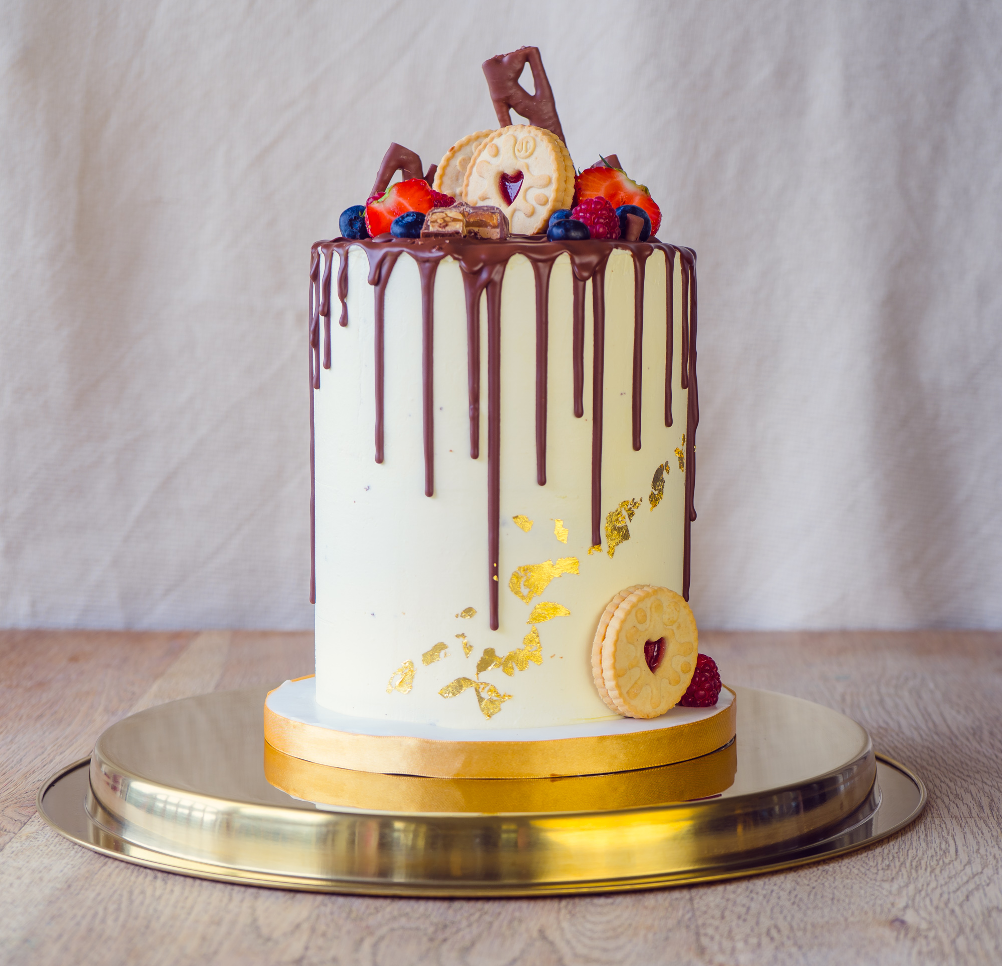 Chocolate drip cake withgold leaf