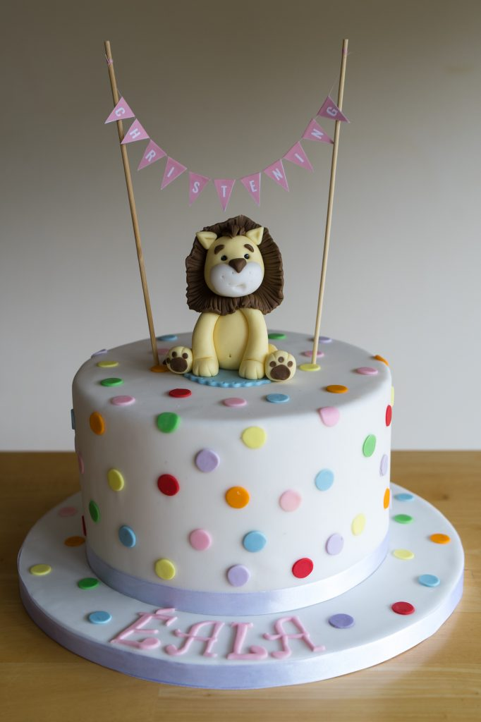 Cute lion and polkadot birthday cake