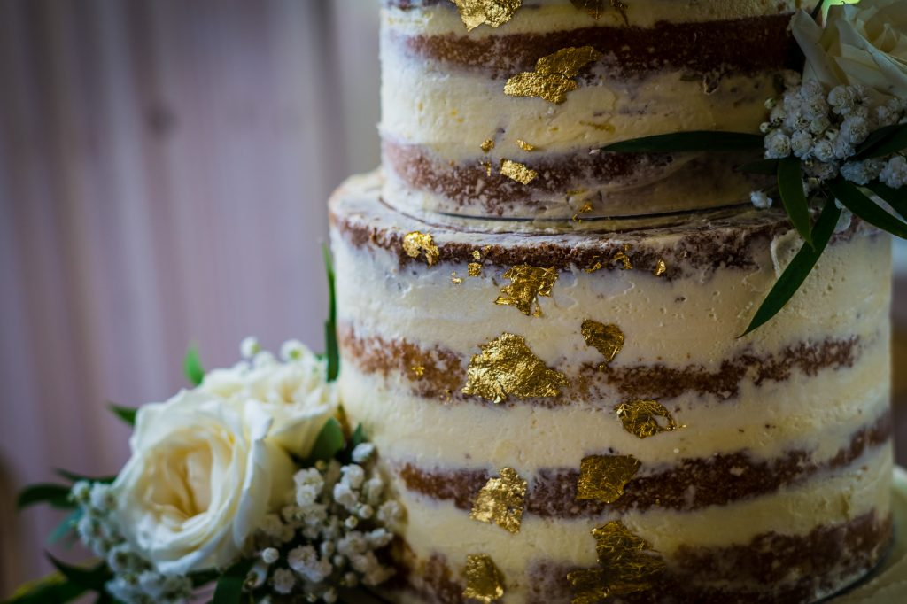 Gold leaf detail on wedding cake