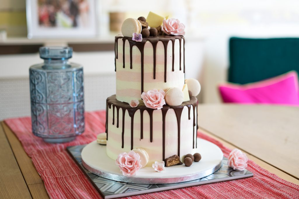 Pink and white striped drip cake