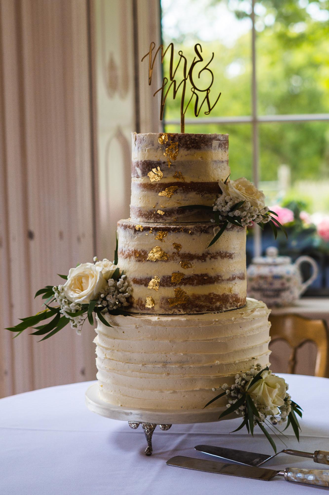 Semin naked and gold leaf wedding cake