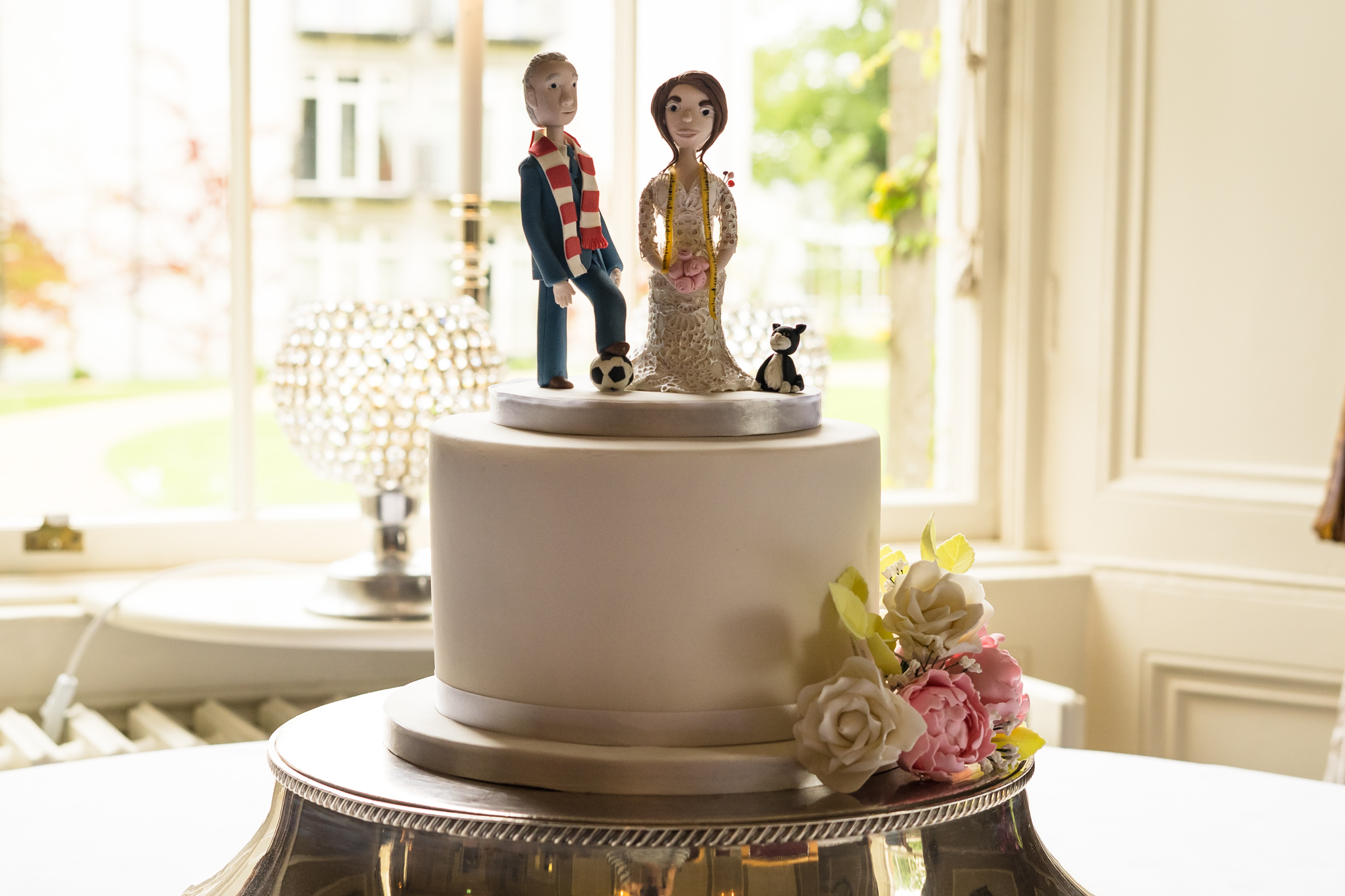 Single tier wedding cake with bespoke topper