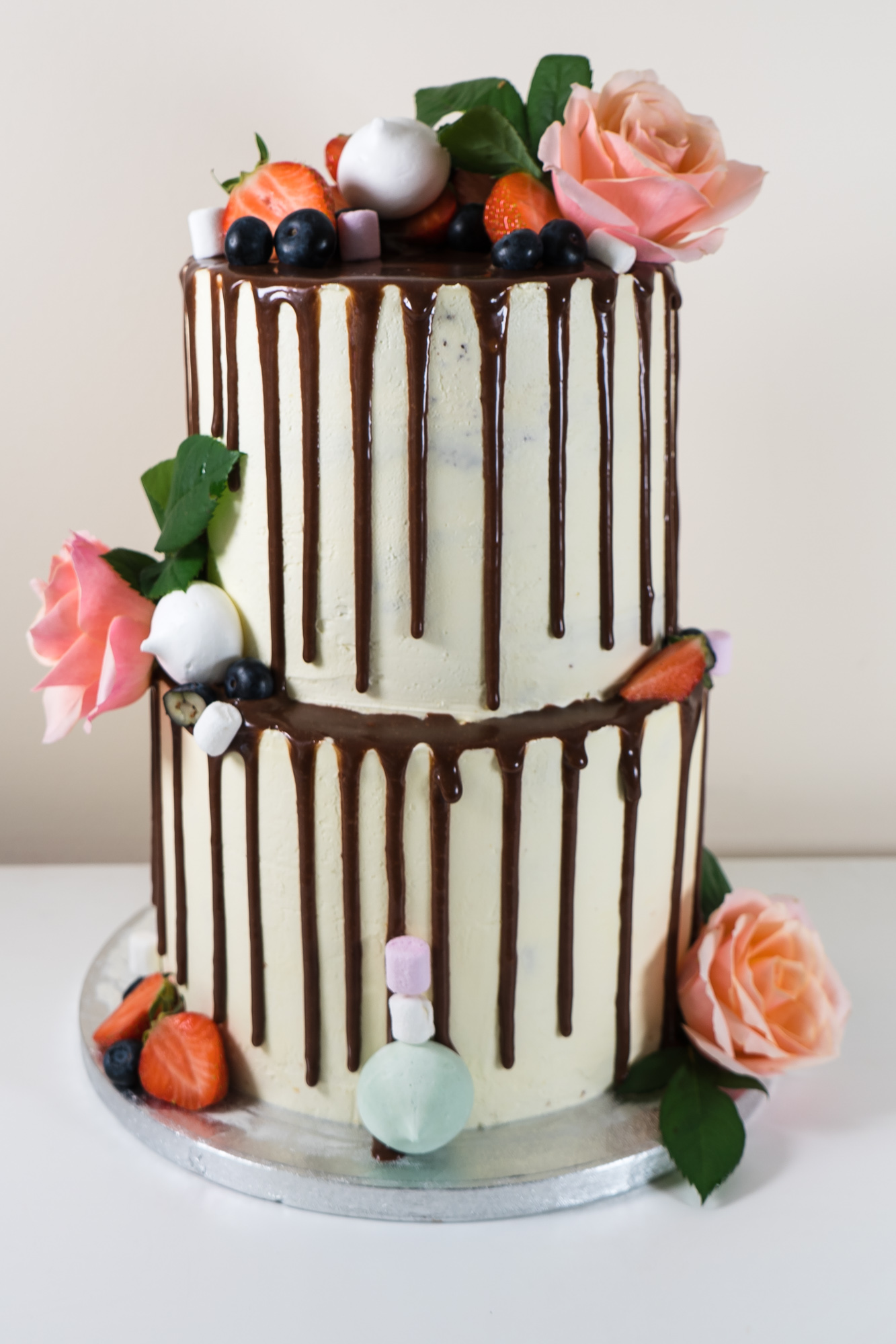 Strawberries and fresh fruit drip cake