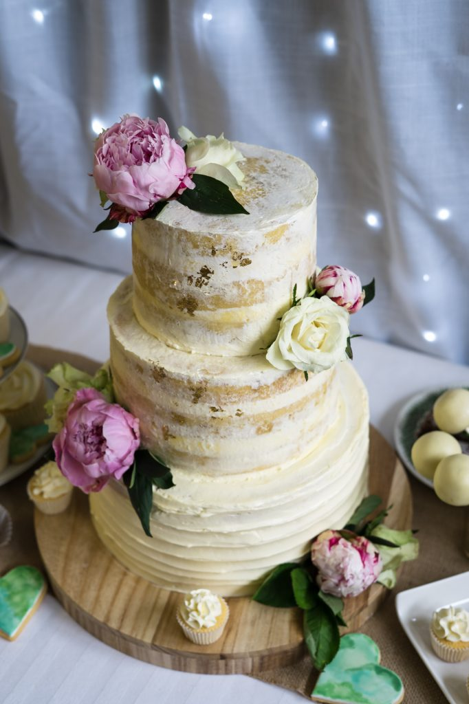 Triple tier semi-naked buttercream wedding cake