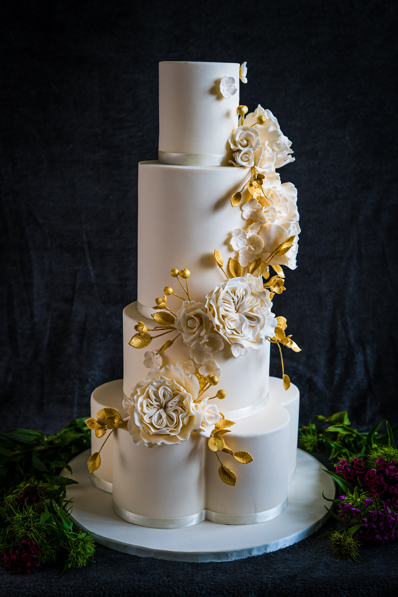 White and gold 4 tier wedding cake