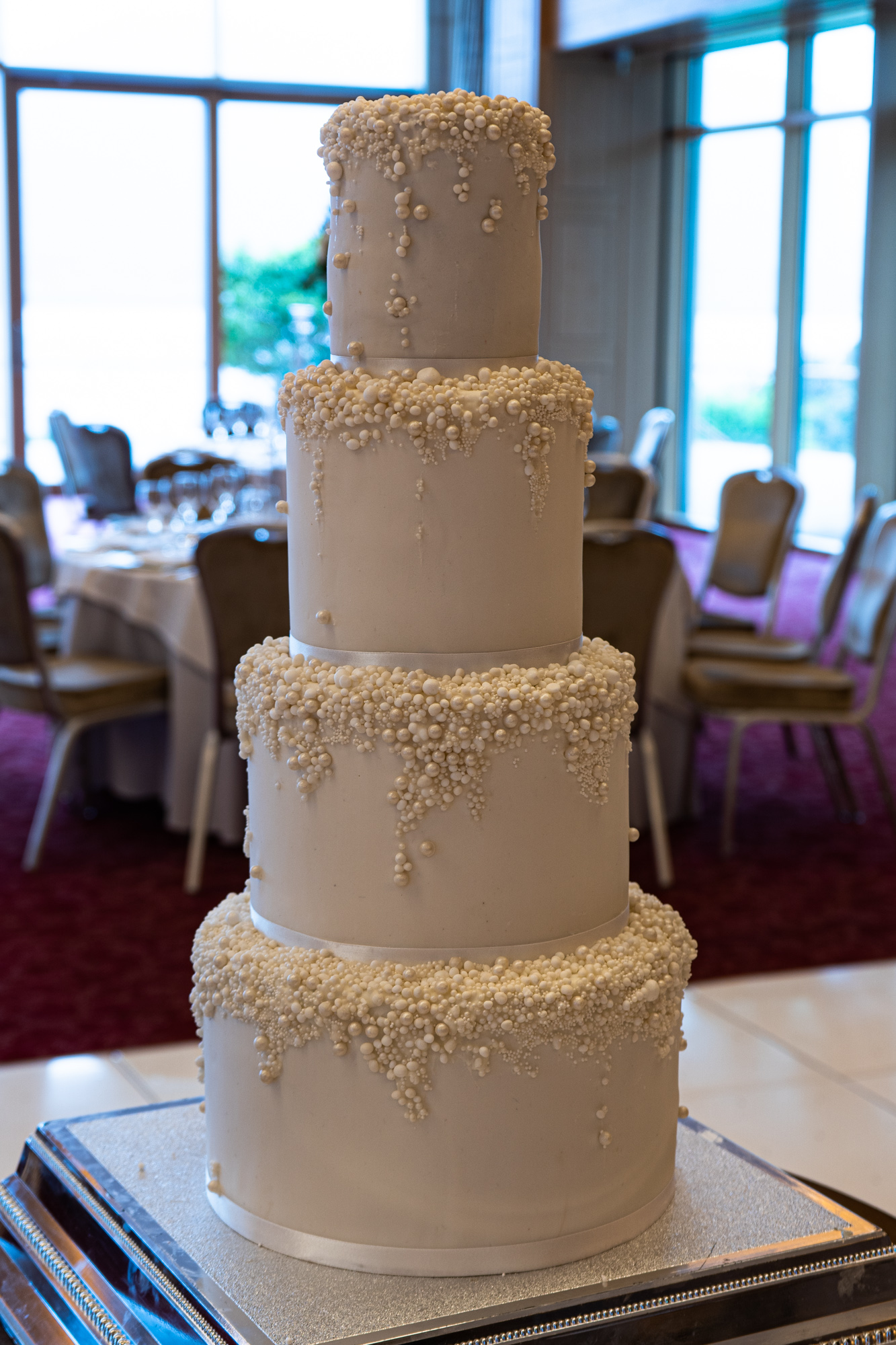 White wedding cake with pearl decorations