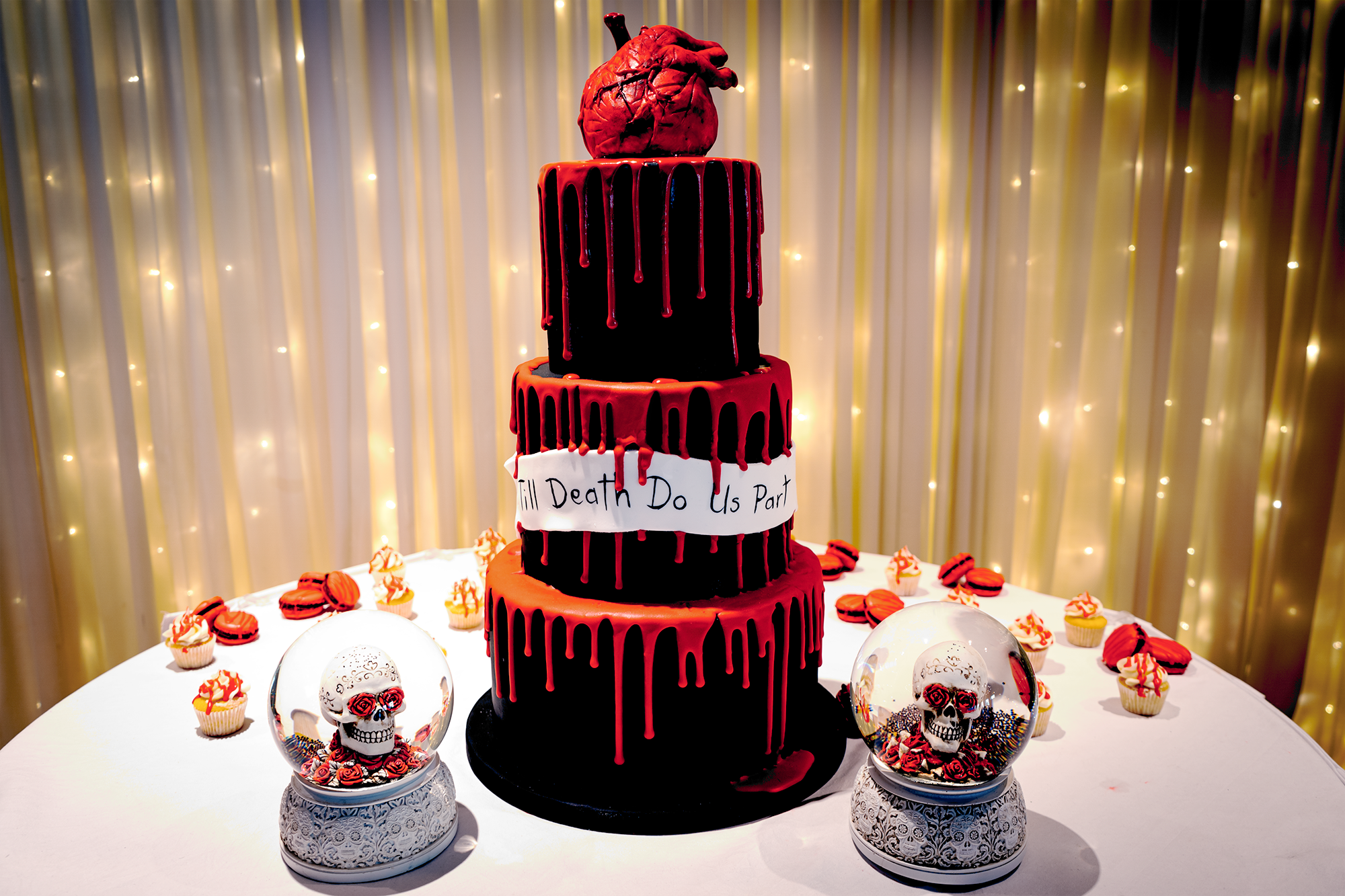 Black and red wedding-cake with heart topper